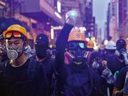 """香港政务司司长:律政司正全面研究""""禁蒙面法"""""""