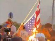 美国多地爆发骚乱:示威者砸超市,烧国旗,围攻警察
